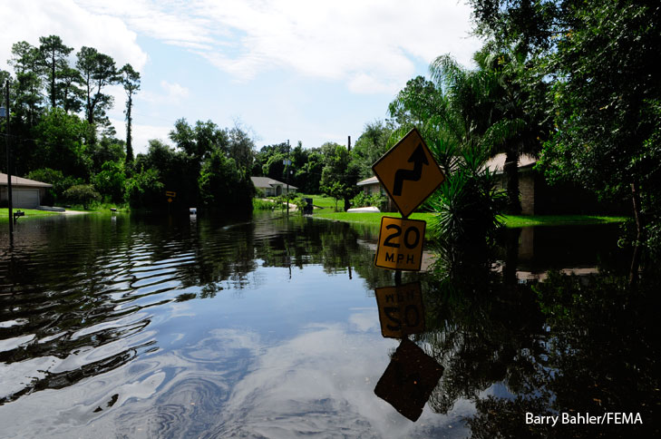 Flooding in a neighborhood after Tropical Storm Fay. Photo by Barry Bahler/FEMA