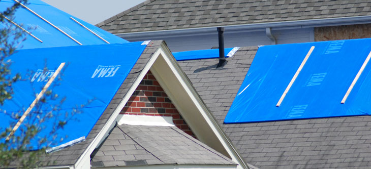 Tarp on roof part of Operation Blue Roof; photo by Army Core of Engineers