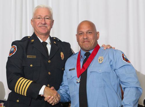 Chief Bogle congratulates Firefighter/Emergency Medical Technician Dooley at the Valor Awards ceremony