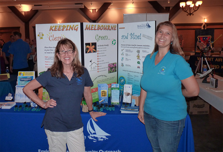 Environmental Community Outreach staff man an exhibit booth where they hand out information about water conservation