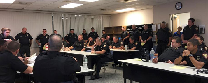 Hurricane Matthew briefing in the squad room at the Melbourne Police Department headquarters building on Apollo Boulevard.
