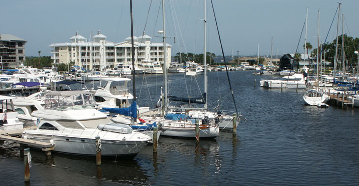 Boats along docks and in the water in Melbourne Harbor and Crane Creek