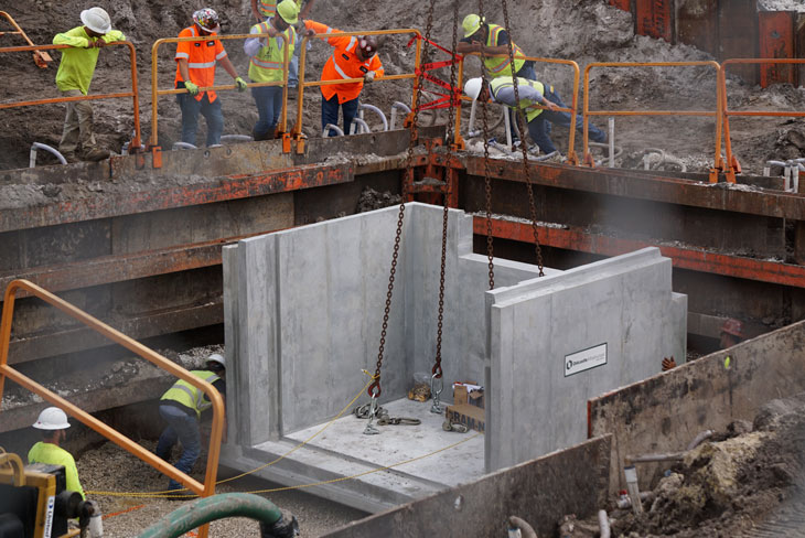 Workers install a piece of a large baffle box at Cliff Creek.