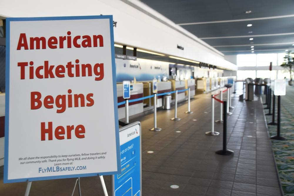 Image of American Airlines ticket counter at Orlando Melbourne International Airport showing markings to help people know where to stand to keep a safe distance apart.